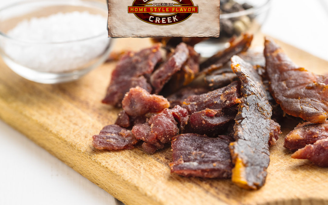 an upclose photo of a different type of jerky than beef, maybe elk, buffalo, or venison